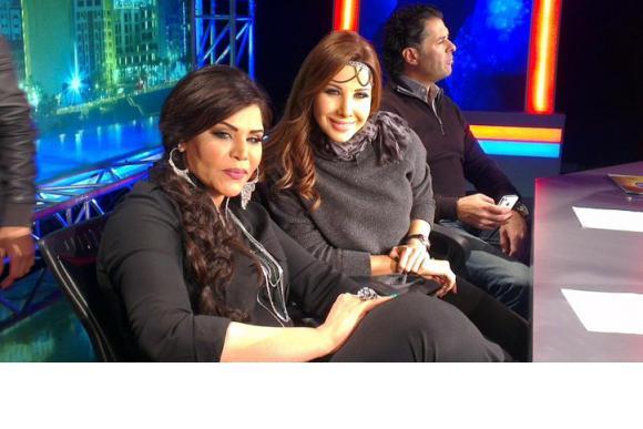 بالصور سباق ألاناقه بَِين نانسى و أحلام فِى بِرنامج عربِ أيدول 2
