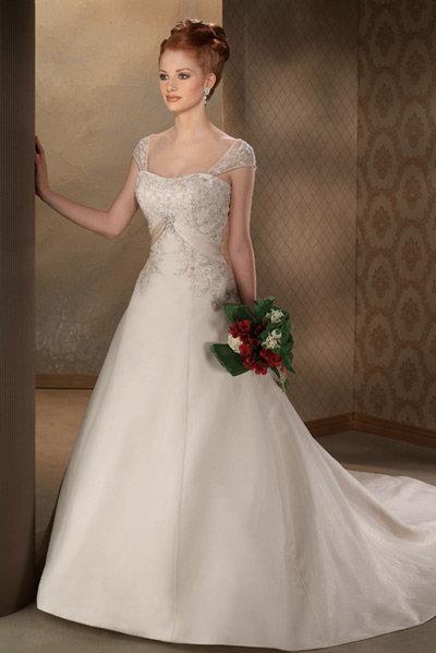 بالصور فساتين زفاف رومانسية تتميز بالهدوء والفخامة للعروس 20160527 383