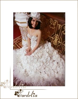 بالصور فساتين زفاف تعرضها الممثلة التركية توبا 20160530 85