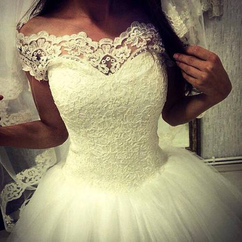 صوره تفسير حلم لبس الفستان الابيض للمتزوجة