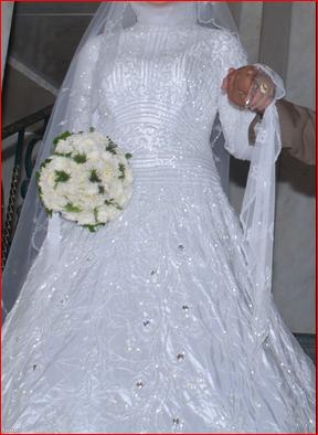 بالصور تفسير حلم لبس الفستان الابيض للمتزوجة 20160627 116